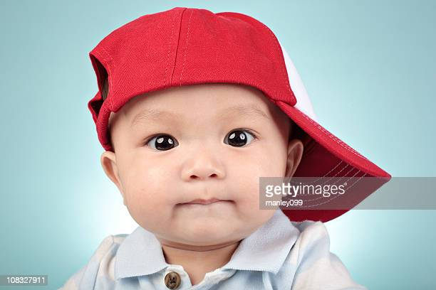 curious baby baseball hat portrait