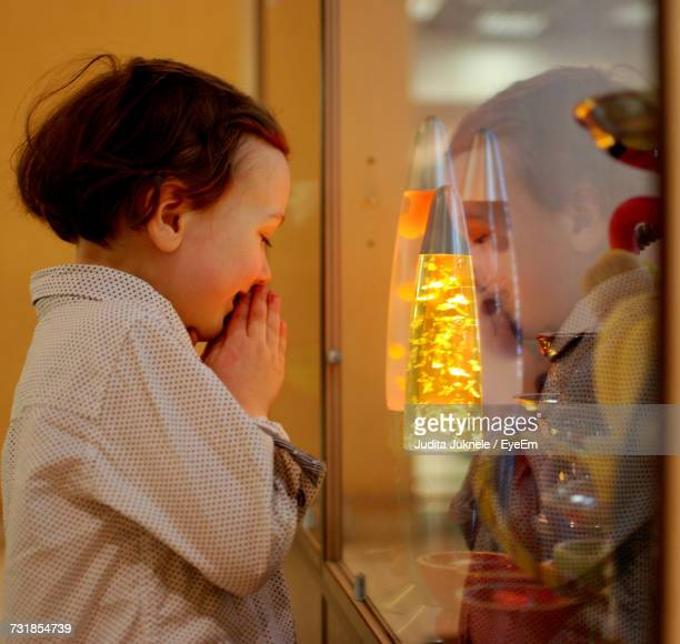 Curious Boy Looking At Display Cabinet