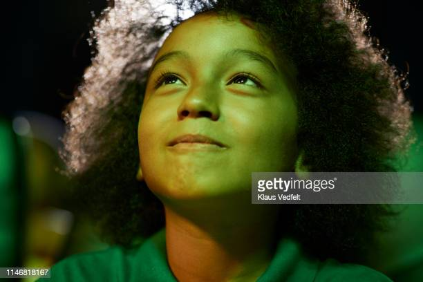 curious boy watching movie at theater - color out of space 2019 film stockfoto's en -beelden
