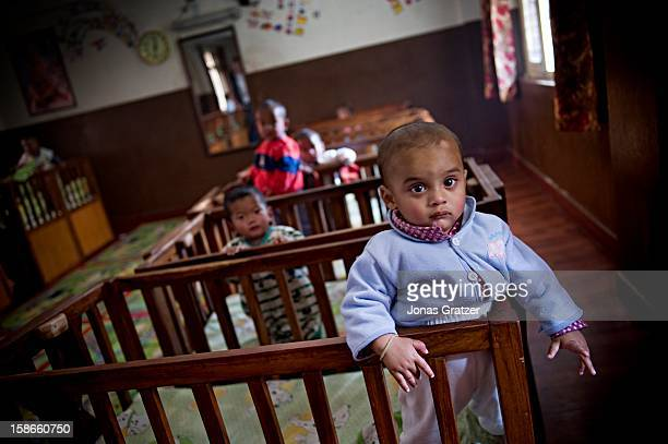 Curious children at the Maiti Nepal kindergarten for children of prostitutes in Kathmandu Maiti Nepal is an organization fighting the sex trade in...