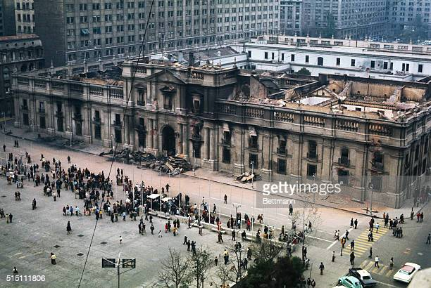 Curious Chileans take a Sunday morning stroll past the wreckage of the recently bombed La Moneda