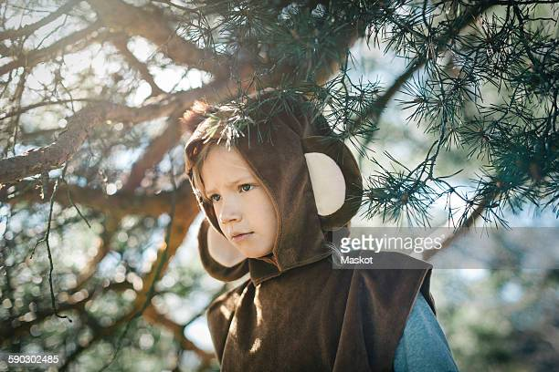 curious girl in monkey suit standing at yard - monkey suit stock pictures, royalty-free photos & images