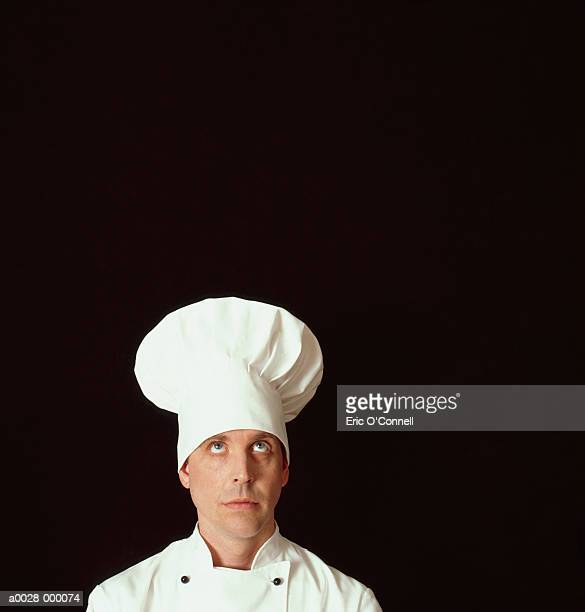 curious looking chef - chef's hat stock pictures, royalty-free photos & images