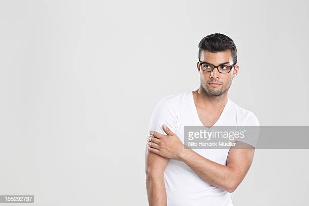 Curious man holding arm