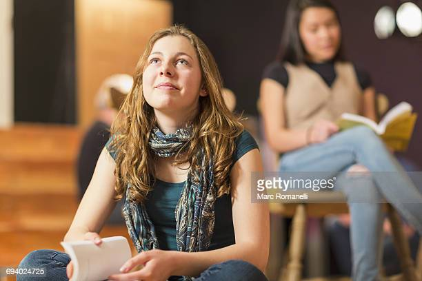 Curious Mixed Race teenage girl in theater class
