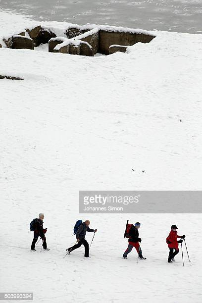 Curious people visit the remains of the former village of Fall revealed during low water at Sylvenstein reservoir in Bavaria on January 7 2016 near...