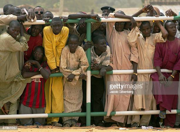 Curious spectators watch as the Emir arrives for the Argungu Fishing Festival on March 18 2004 in Argungu Nigeria The Argungu Fishing Festival was...