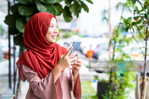 curious tourist girl exploring the city while taking pictures of - malaysia beautiful girl stock photos and pictures