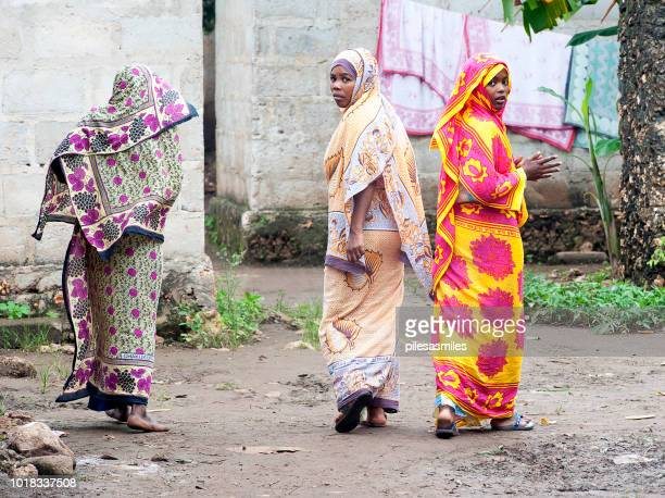curious trio, tumbatu isalnd, zanzibar, tanzania - shawl stock pictures, royalty-free photos & images