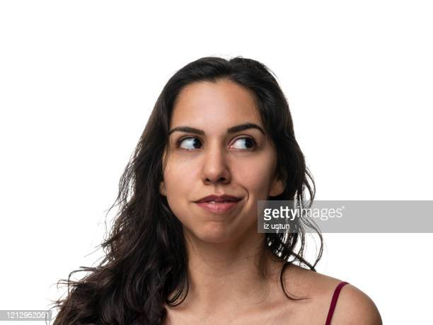 curious woman looking away - black hair stock pictures, royalty-free photos & images