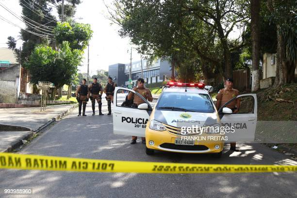 Curitiba´s police officers block the street that leads to the Federal Police Headquarters in Curitiba Parana State Brazil on July 8 2018 A Brazilian...