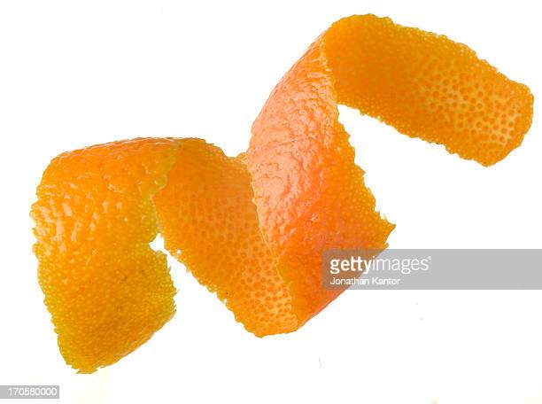 curl of orange peel - curled up stock pictures, royalty-free photos & images