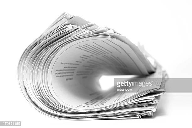 Curled newspaper