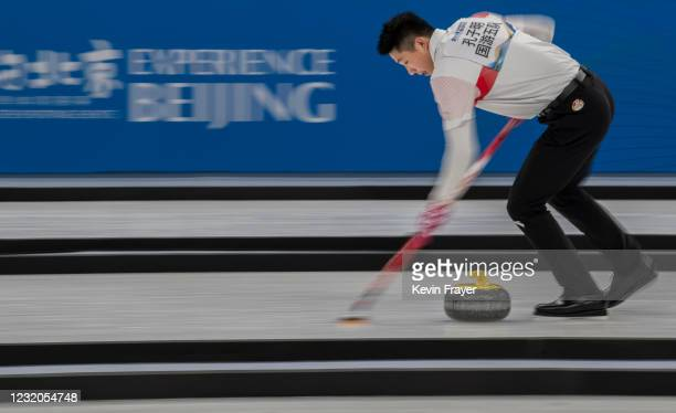 Curler from China's curling team sweeps a rock during a mixed test event for the Beijing 2022 Winter Olympics at the Water Cube on April 1, 2021 in...