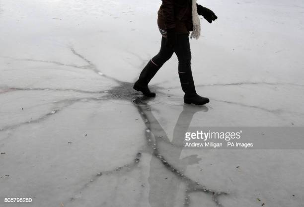 CROP A curler plays a game near a crack in the ice on the wet surface of the Lake of Menteith as the thaw begins An outdoor curling tournament was...