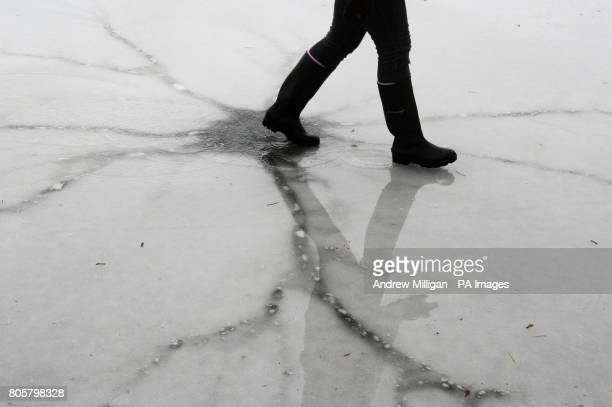 A curler plays a game near a crack in the ice on the wet surface of the Lake of Menteith as the thaw begins An outdoor curling tournament was called...