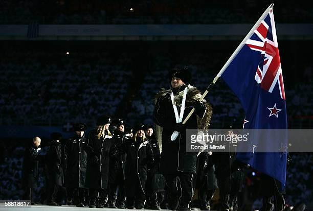 Curler Sean Becker carries New Zealand's flag during the Opening Ceremony of the Turin 2006 Winter Olympic Games on February 10 2006 at the Olympic...