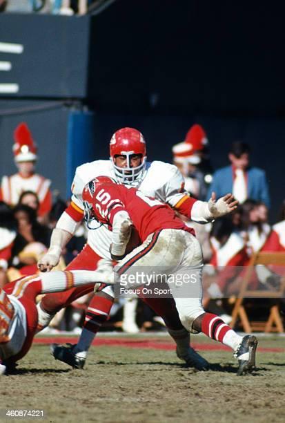 Curley Culp of the Kansas City Chiefs hits Art Malone of the Atlanta Falcons during an NFL football game December 17 1972 at Atlanta Stadium in...