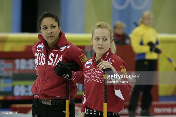 Curling 2006 Winter Olympics Russia Nkeirouka Ezekh and Yana Nekrasova during Women's Round Robin Session 2 Sheet D at Palaghiaccio Pinerolo Italy...