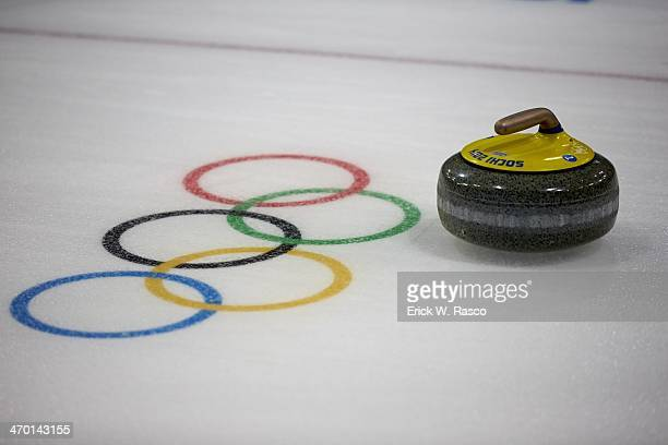 2014 Winter Olympics View of stone next to Olympic rings on ice during Women's Round Robin Session 10 at Ice Cube Curling Center Equipment Sochi...