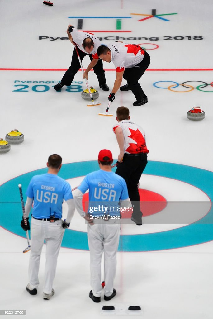 Team Canada sweepers Brent Laing and Ben Hebert in action vs Team USA John Schuster and Tyler George during Men's Round Robin Session 9 at Gangneung Curling Centre. Erick W. Rasco X161685 TK1 )