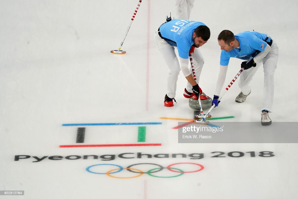 Team USA sweepers John Landsteiner and Tyler George in action vs Team Canada during Men's Round Robin Session 9 at Gangneung Curling Centre. Erick W. Rasco X161685 TK1 )