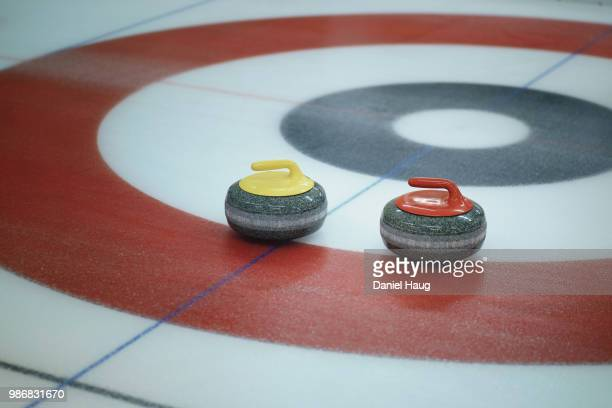 curling rocks inside target - curling stone stock pictures, royalty-free photos & images