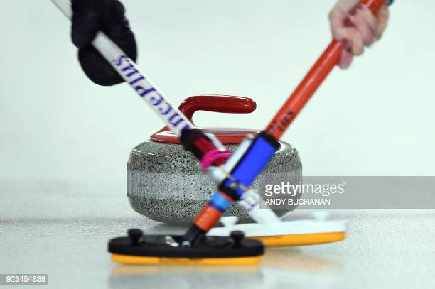 Curling sticks and a curling stone are pictured as women competitors participate in the Scottish Senior Curling Championships which feature...