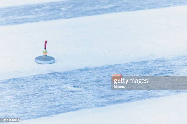 curling stone and target marking. outdoor curling rink. ice stock sport. - winter sports event stock pictures, royalty-free photos & images