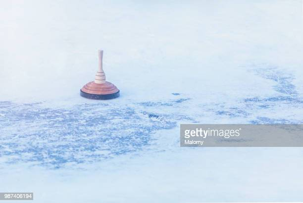 curling stone. outdoors curling rink. ice stock sport. - winter sports event stock pictures, royalty-free photos & images