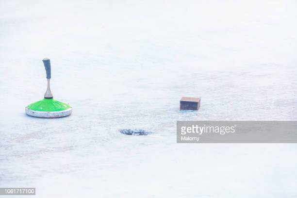 curling stones and target marking. outdoor curling rink. ice stock sport. - winter sports event stock pictures, royalty-free photos & images