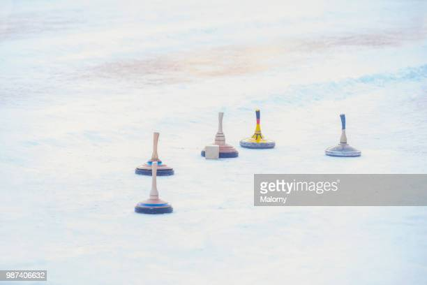 curling stones. outdoor curling rink. ice stock sport. - winter sports event stock pictures, royalty-free photos & images