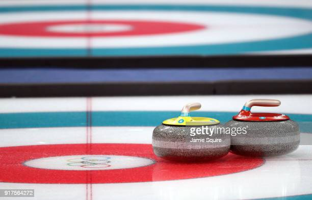 Curling stones sit on the ice during the Curling Mixed Doubles Bronze Medal Game between Olympic Athletes from Russia and Norway on day four of the...