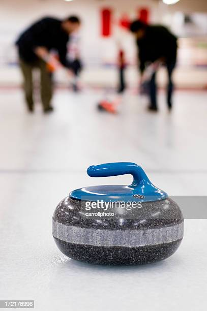 curling team in action - curling stone stock pictures, royalty-free photos & images