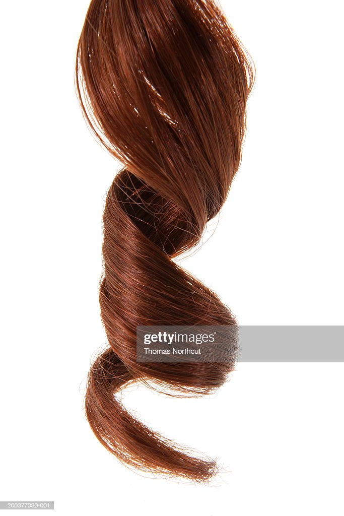 Curly hair, close-up of ringlet : Stock Photo