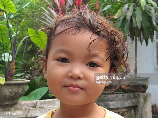 curly hair girl - nga nguyen stock pictures, royalty-free photos & images