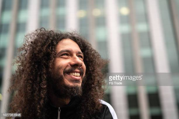 curly hair man portrait - ugly smile stock pictures, royalty-free photos & images
