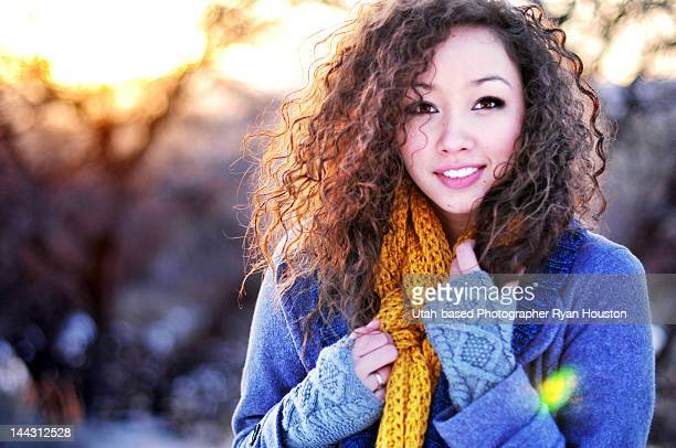 Curly Haired Brunette in Winter Clothing