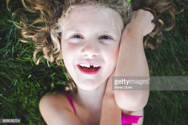 Curly Haired girl With Missing Tooth