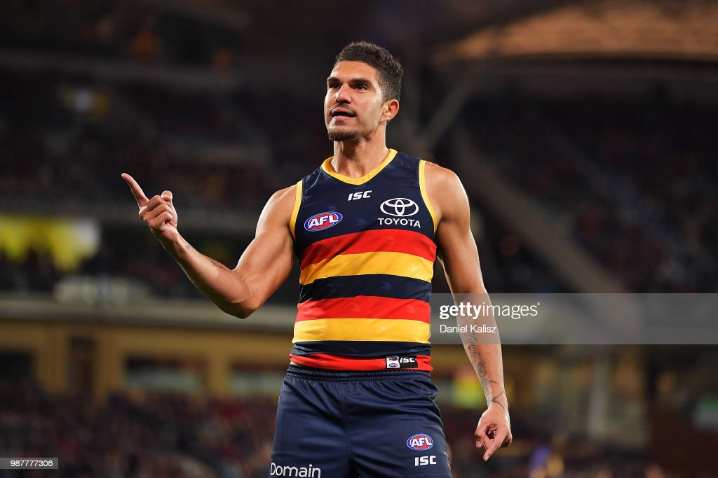 Curly Hampton of the Crows celebrates after kicking a goal during the round 15 AFL match between the Adelaide Crows and the West Coast Eagles at Adelaide Oval on June 30, 2018 in Adelaide, Australia.