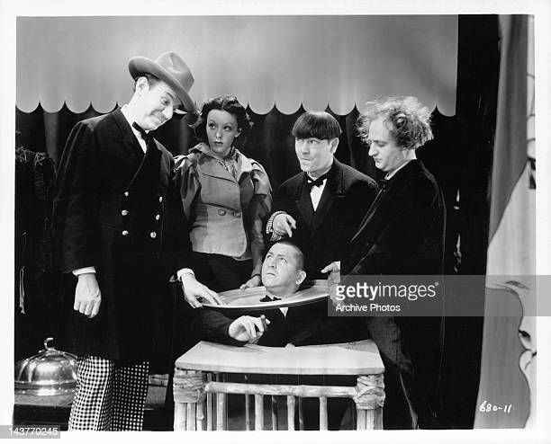 Curly Howard Moe Howard and Larry Fine as the Three Stooges in a scene from uknown film Circa 1940