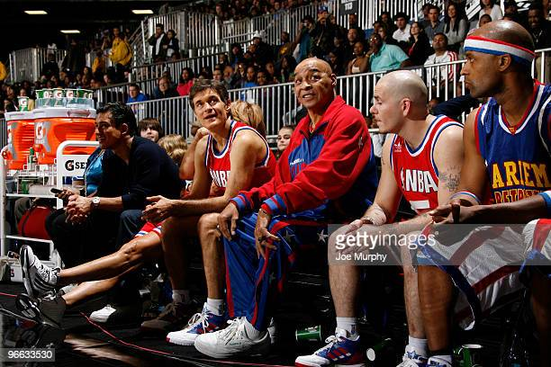 Curly Neal former Harlem Globe Trotter TV personality Dr Oz and Musician Pitbull talk during the 2010 NBA AllStar Celebrity Game presented by FINAL...