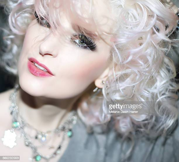 Curly platinum blonde woman