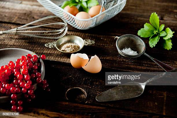 currants, eggs and sugar for a baking day - carolafink stock photos and pictures