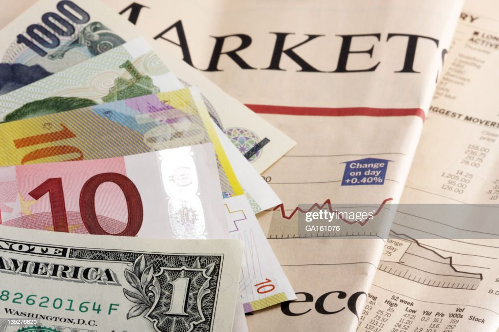 Currencies on a newspaper : Stock Photo