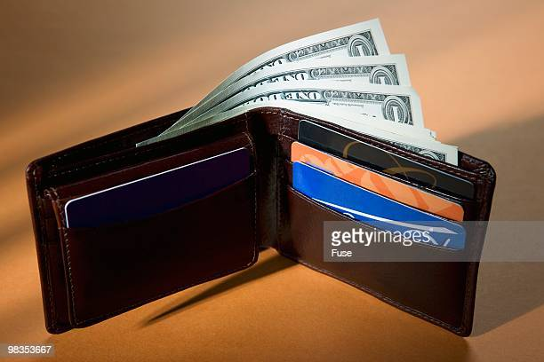 US currency and credit cards in wallet