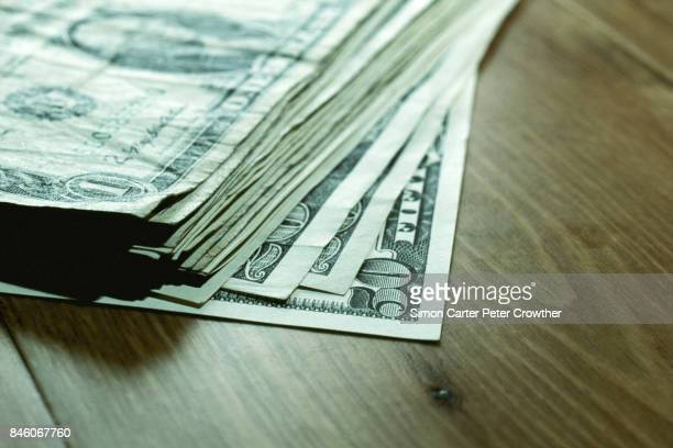us currency: banknotes on table, close-up. - us dollar note stock photos and pictures