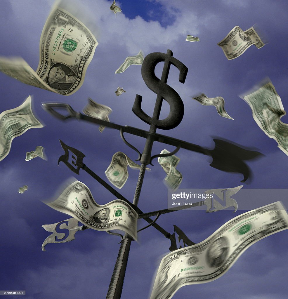 US currency blowing around weather vane (Digital Composite) : Stock Photo