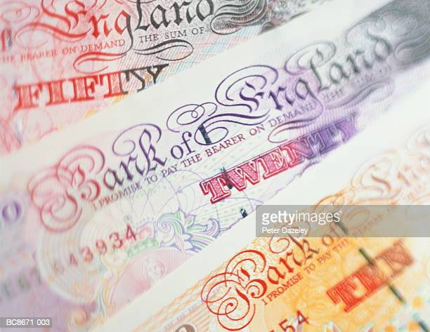 uk currency: english ten, twenty and fifty pound notes, close-up - british pound note stockfoto's en -beelden