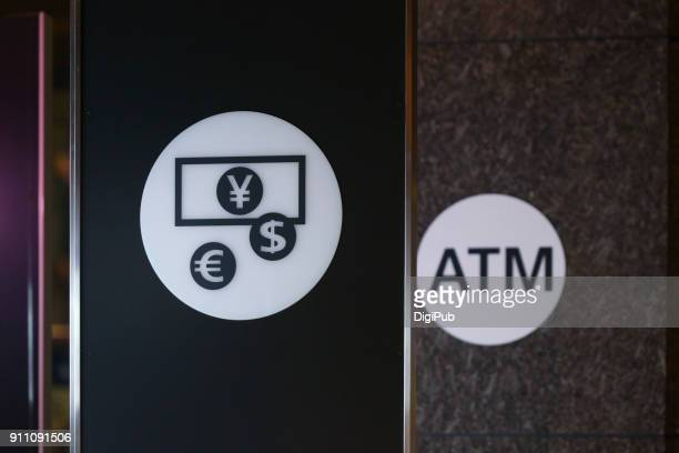 Currency exchange and ATM signs in Tokyo